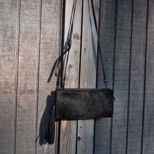 Black python embossed leather clutch